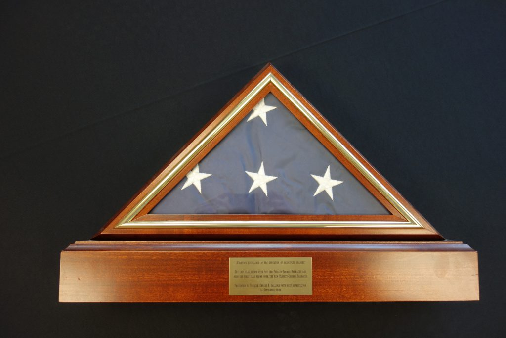 The last American flag to fly over the original Padgett-Thomas Barracks and the first flag to fly over the newly rebuilt barracks