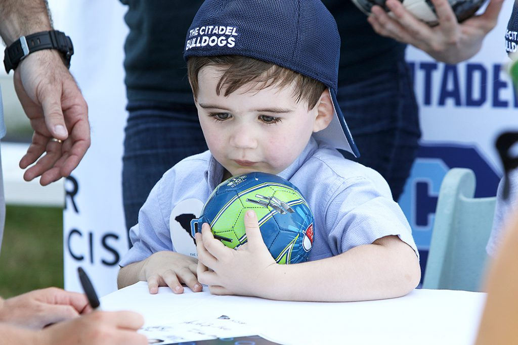 Milo with signed soccer ball