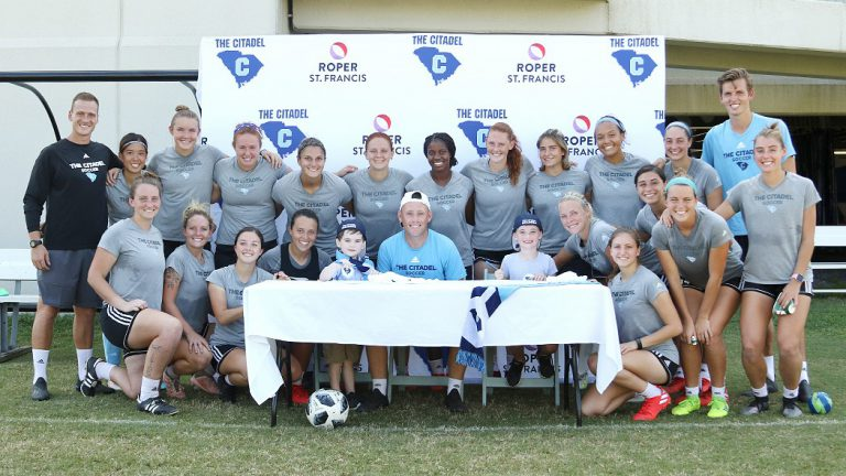 The Citadel women's soccer team with two new members
