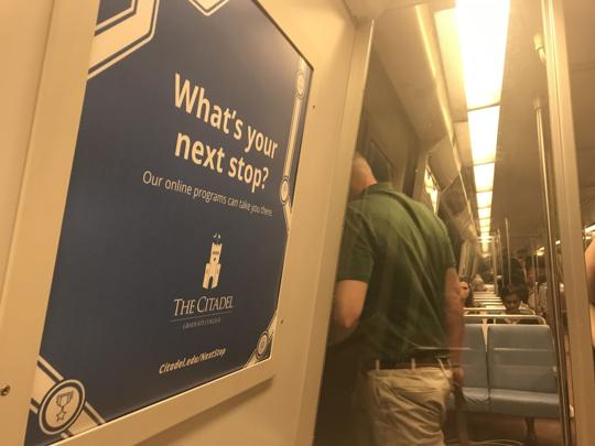 This ad in a Washington DC subway train is part of a $500,000 campaign The Citadel is undertaking to market its growing online course offerings. (Courtesy: Robert Behre, The Post and Courier)