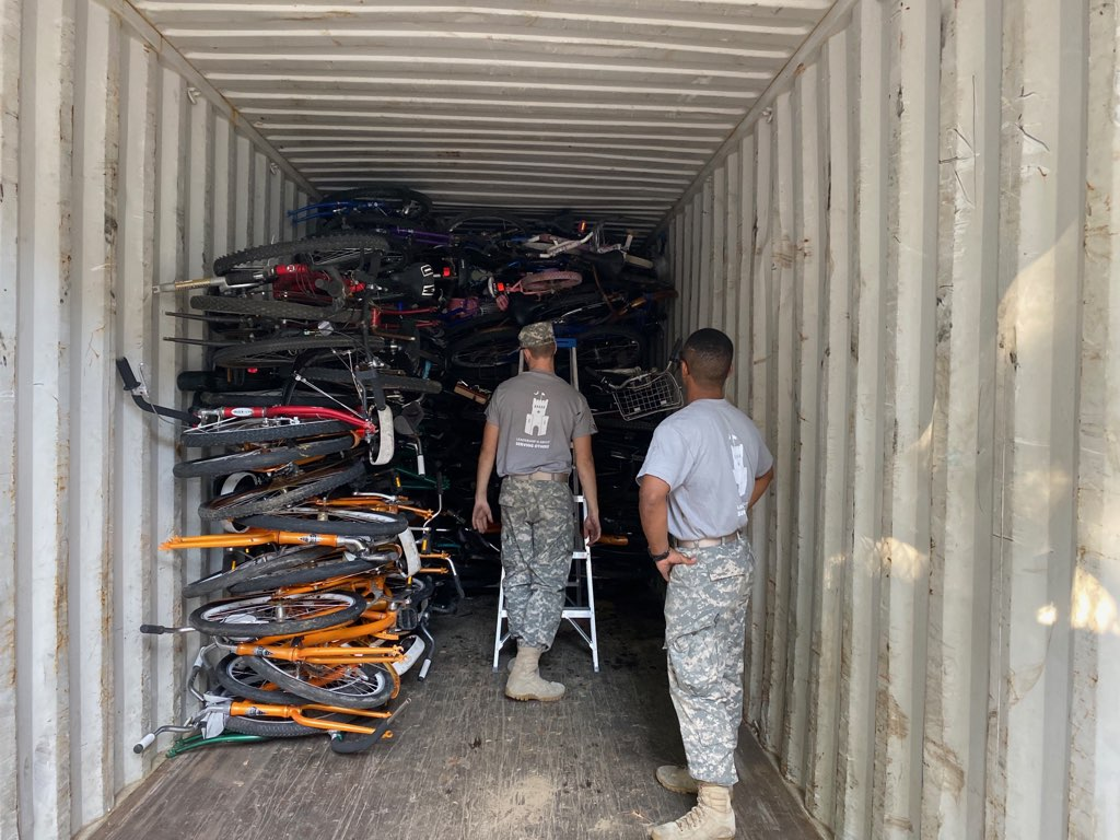 Crate of bikes at Bicycles for Humanity