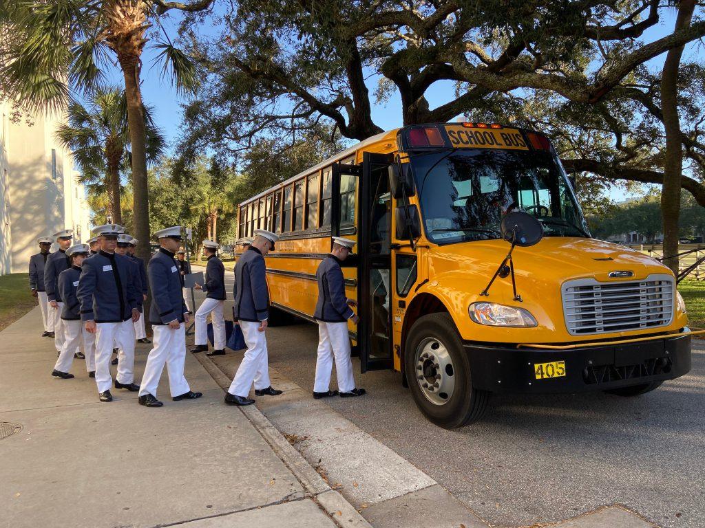 Freshmen cadets boarding buses
