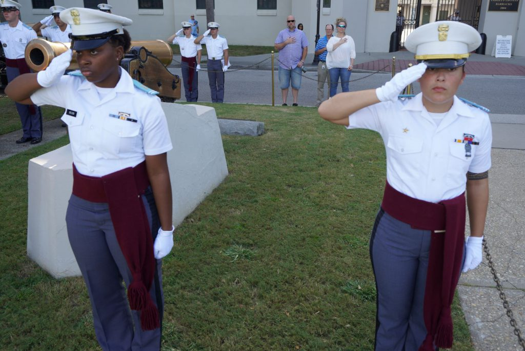 Ruby Bolden and Breana Broad saluting during parade