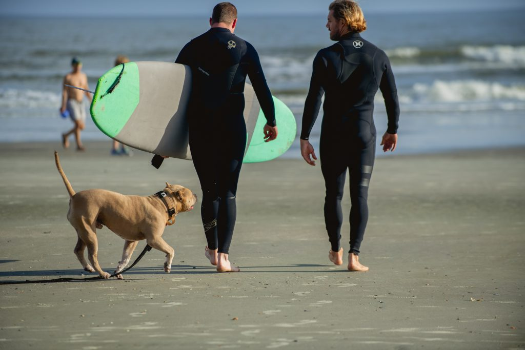 Veteran preparing to surf, with instructor. Photo courtesy of Warrior Surf