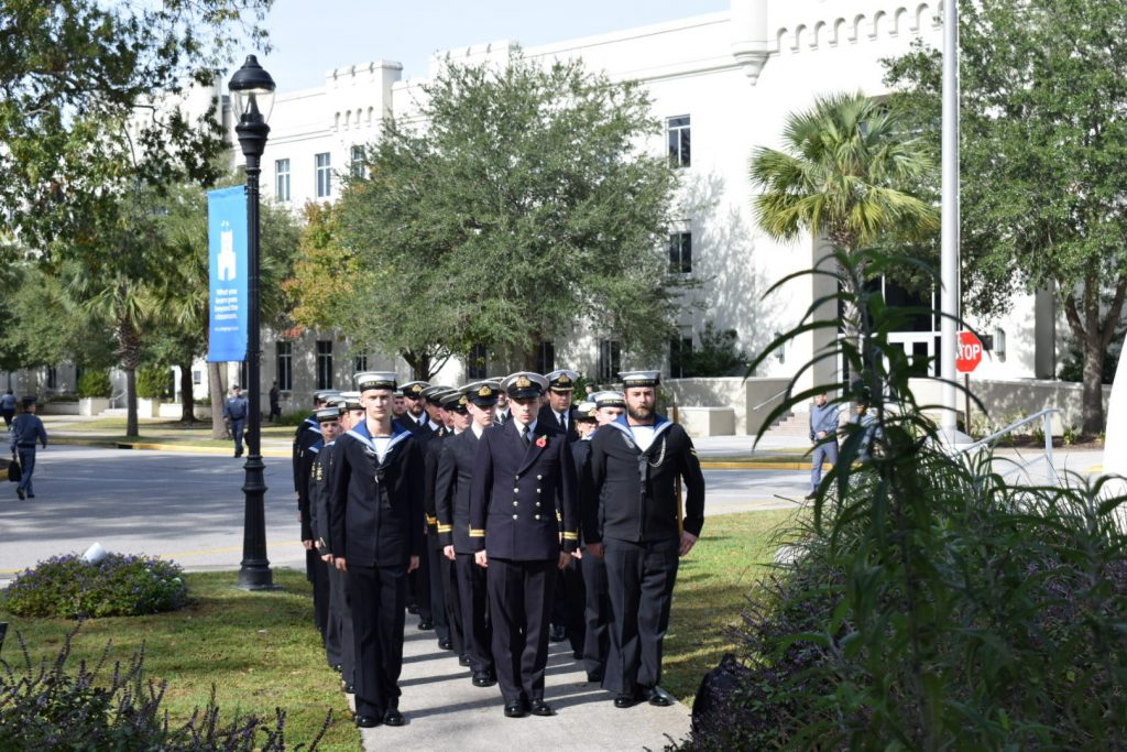 British Royal Navy officers and sailors visit the Seraph Monument at The Citadel