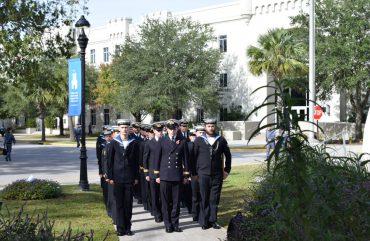 British Royal Navy officers and sailors visit the Seraph Monument at The Citadel
