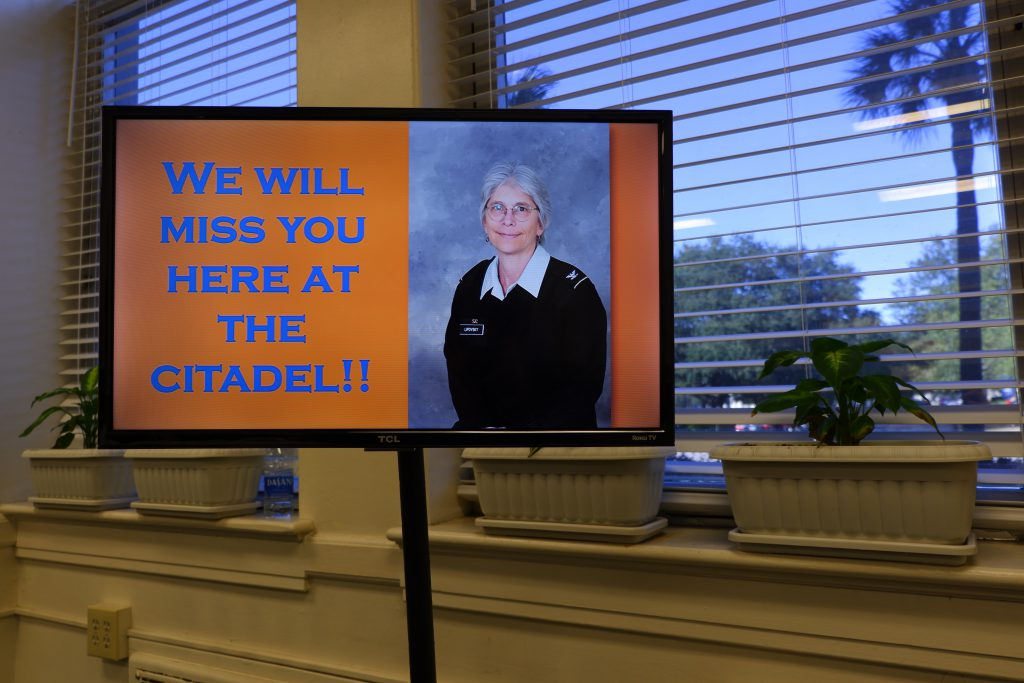 A digital sign with photo of Dr. Julie Lipovsky that says We will miss you at the Citadel.