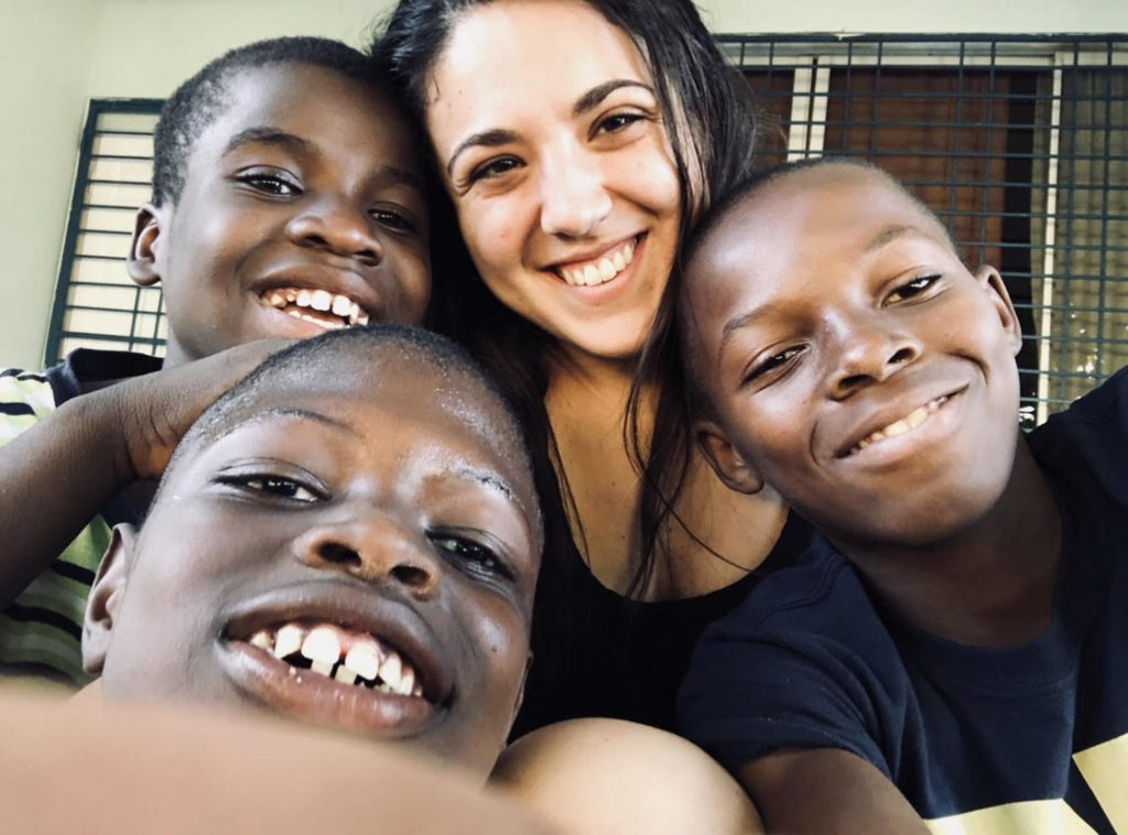 Leeanne Leary with students in Haiti