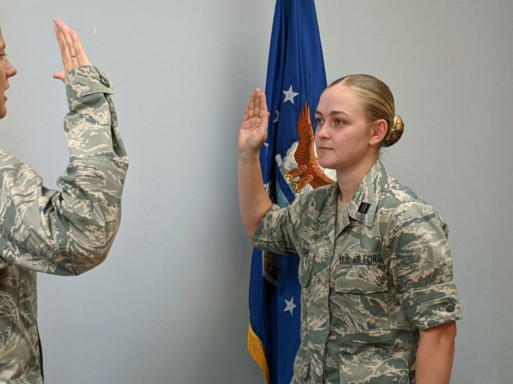 Cadet Lillian Layden being sworn in as USAF ROTC contract cadet