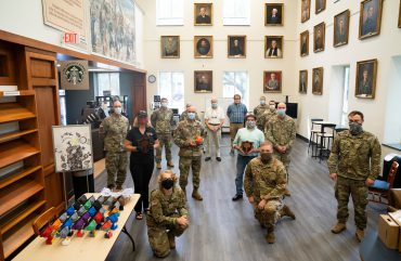 SC Guard members and others in Citadel's Daniel Library working to make masks for healthcare workers