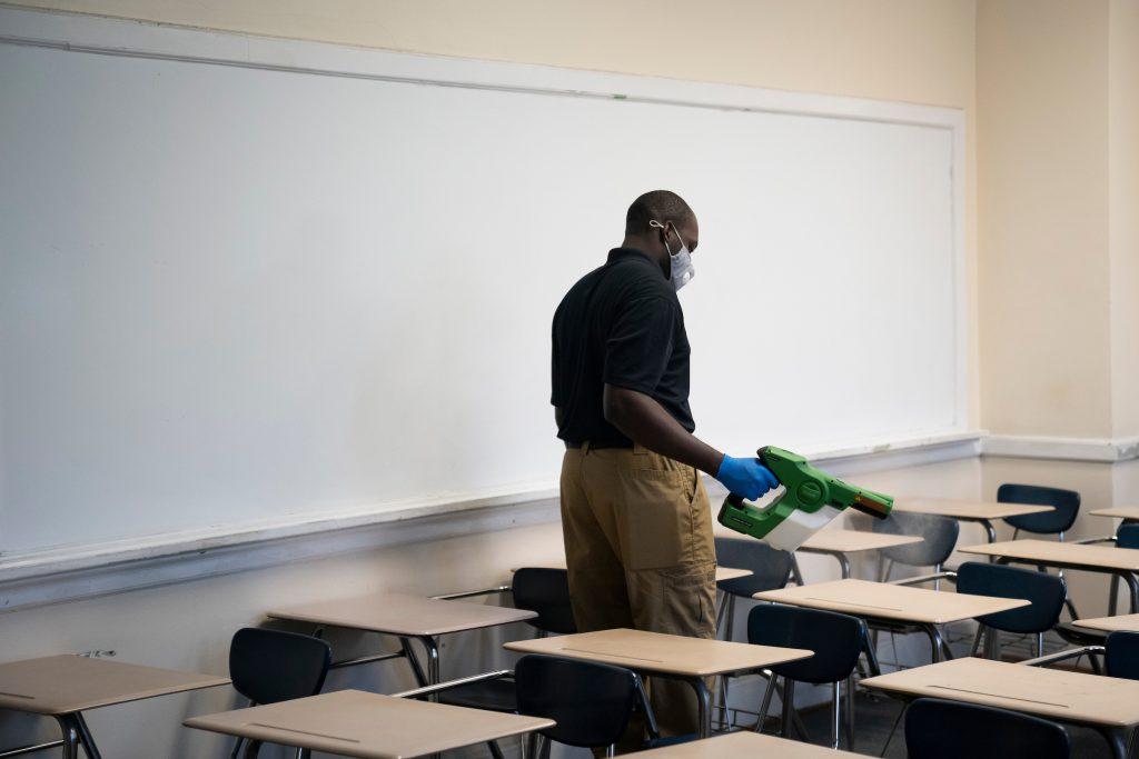 L'Quante Hill demonstrates an electrostatic atomizer in a Capers Hall classroom at The Citadel in Charleston, South Carolina