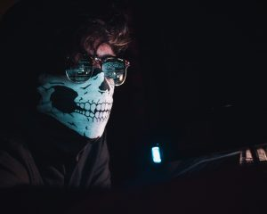 Photo of man wearing skeleton mask disguise