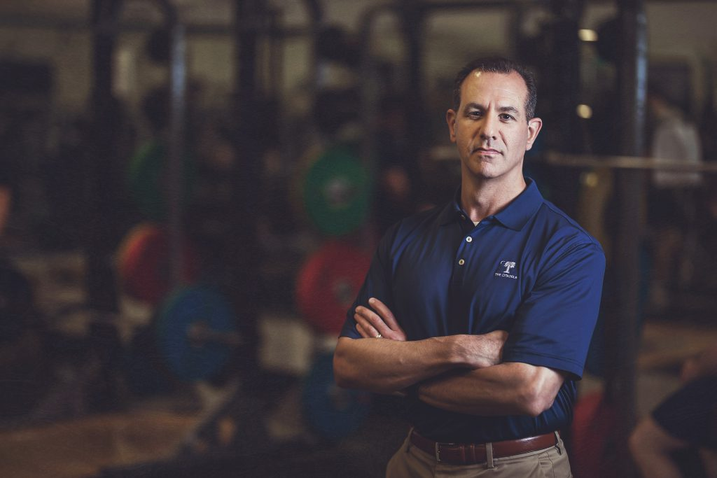 Dr. Dan Bornstein photographed in Citadel weight room in 2018