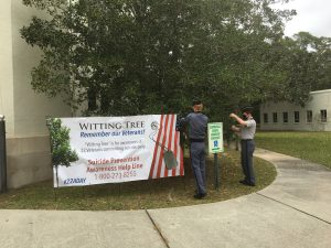 Cadets place dog tags on Whitting Tree on campus