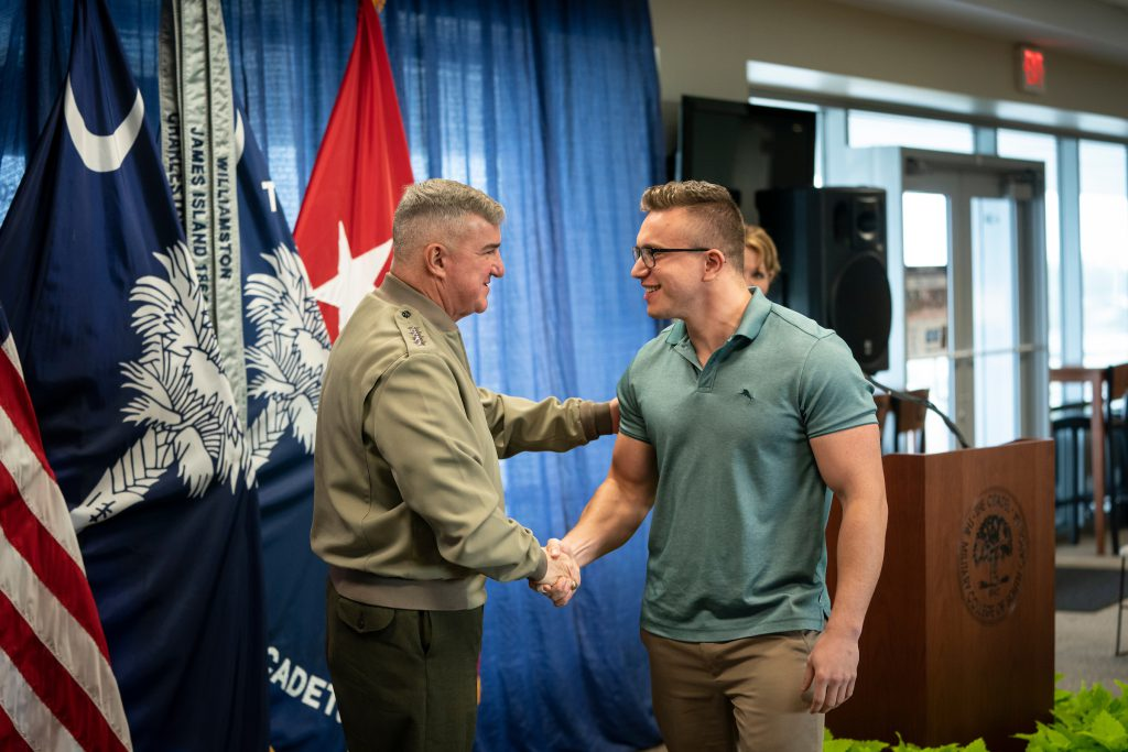 The Citadel President, Gen. Glenn M. Walters, USMC (Ret.) congratulating a veteran student who earned an award in January of 2020