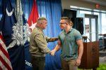 The Citadel President, Gen. Glenn M. Walters, USMC (Ret.) congratulating a veteran student who earned an award in January of 2020