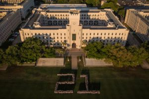 Class of 21 cadets on The Citadel's Summerall Field forming the number 21