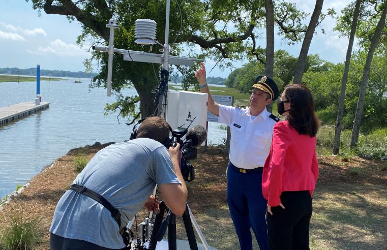 National news correspondent Maya Rodriguez listens to Citadel professor Dr. Scott Curtis discuss the college's weather station on campus