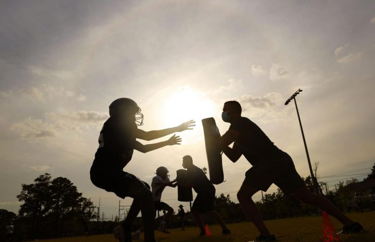 Post and Courier photo of Lucy Beckham HIgh school football players practicing in summer