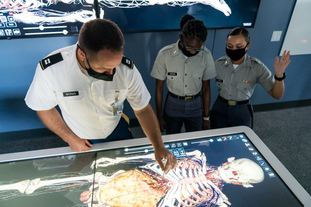 Cadets work with Dr. Clinton Moran, Biology, on a new Anatomage table, the newest addition to Duckett Hall's state-of-the-art anatomy and physiology lab at The Citadel in Charleston, South Carolina on Tuesday, August 31, 2021. Credit: Cameron Pollack / The Citadel