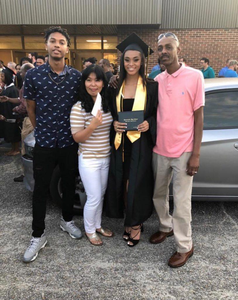 Cadet Mya Dollard with family at high school graduation